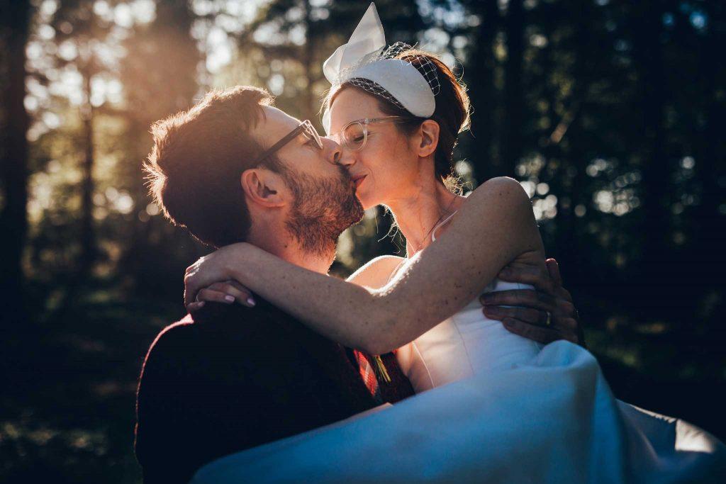 Boconnoc House woodland bride and groom kiss