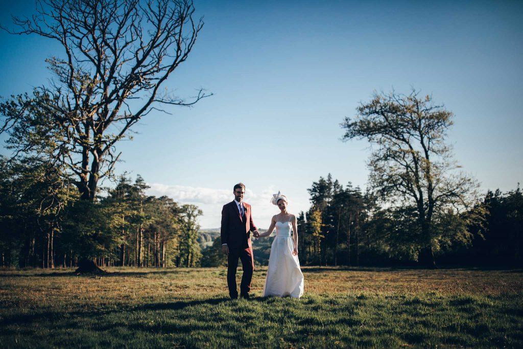 Boconnoc House bride and groom at obelisk
